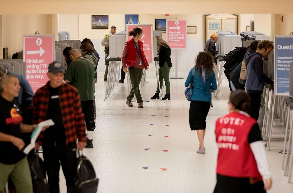 Poll workers and voters move through the basement level of San Francisco City Hall during Election Day in San Francisco, Calif. Tuesday, Nov. 5, 2019.