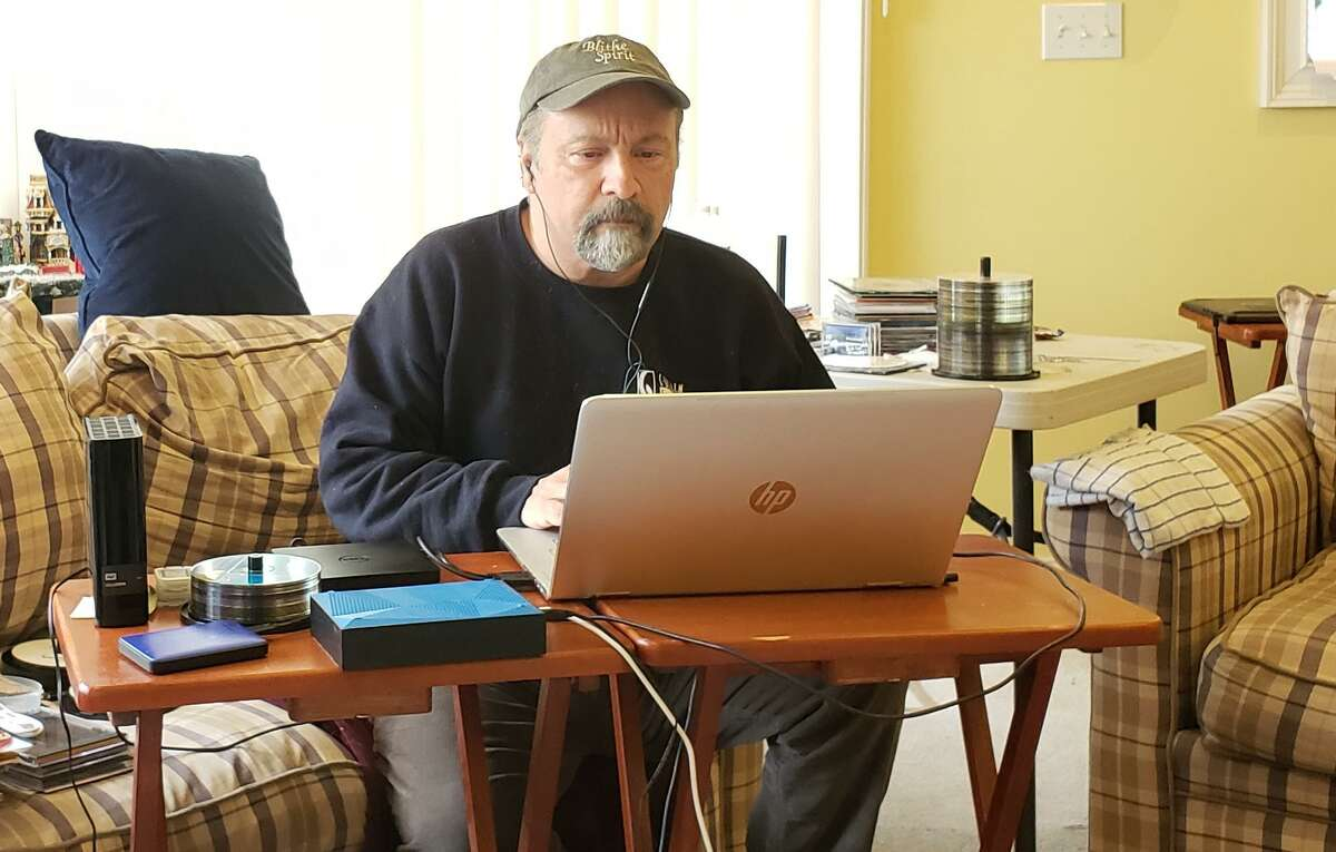 Curtain Call's executive director Lou Ursone works at a laptop editing daily video clips he emails to the Stamford nonprofit troupe's audience as a way to stay connected during the caronavirus pandemic.