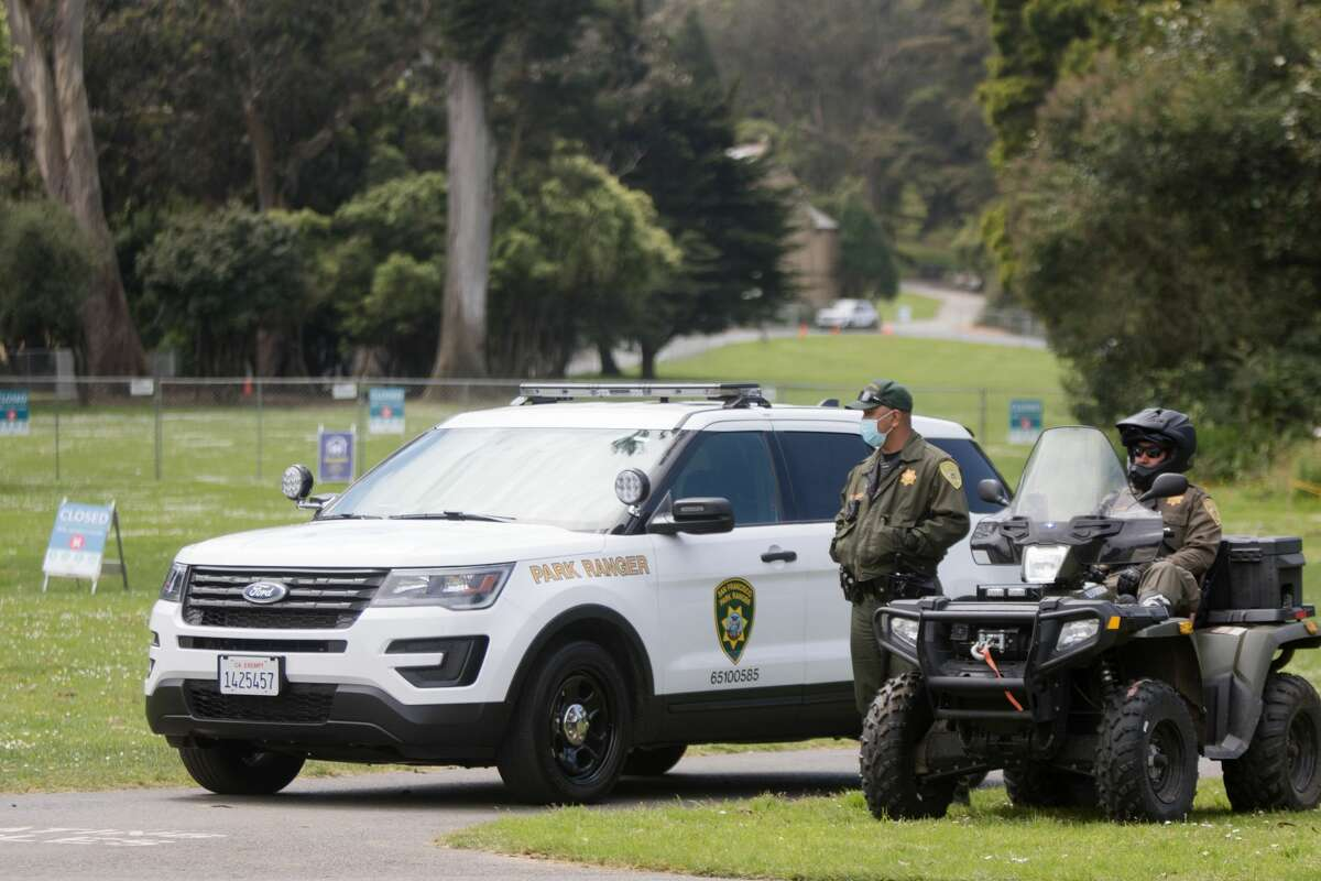 San Francisco Park Rangers patrol in SUV's and All-terain vehicles near Golden Gate Park's Hippie Hill on 4/20.