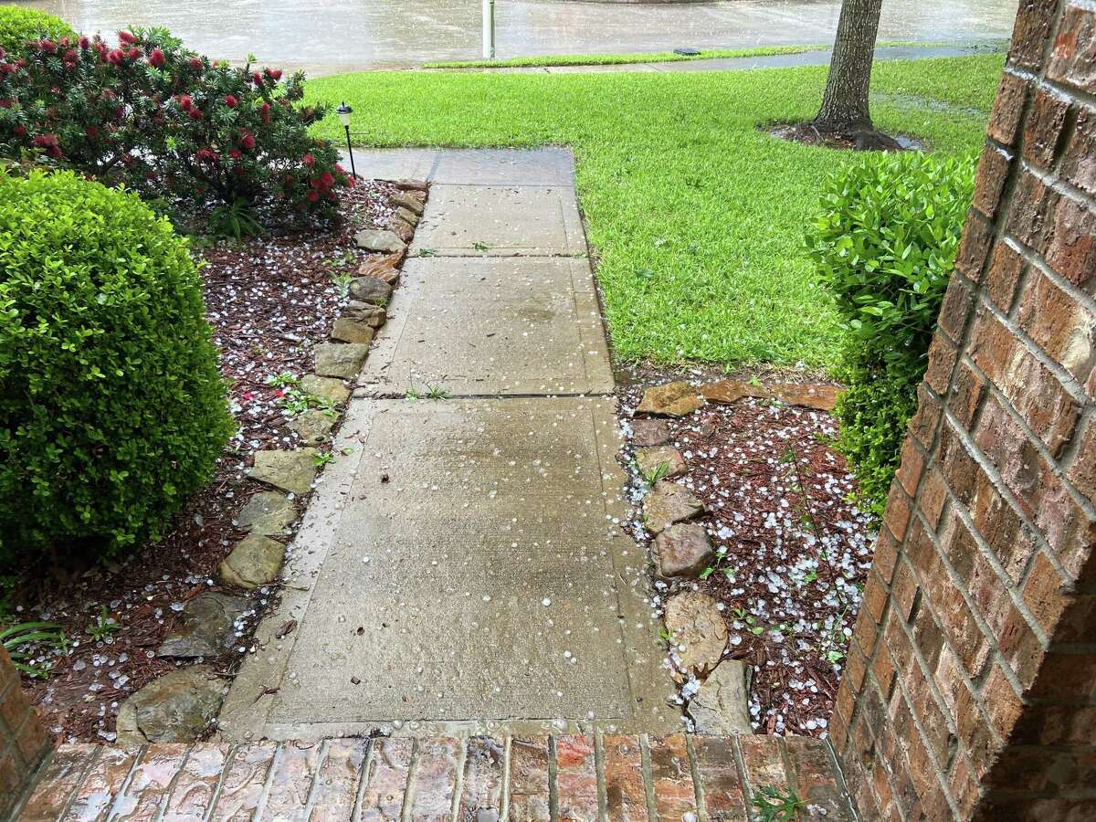In a storm on Saturday, April 18, Luisa Aparicio's home in the Raintree Village subdivision of Katy takes on quarter-sized hail. Aparacio quickly had her roof inspected and advises other homeowners that saw hail to do the same to possibly prevent future damage.
