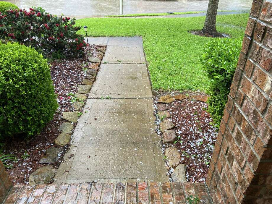 In a storm on Saturday, April 18, Luisa Aparicio's home in the Raintree Village subdivision of Katy takes on quarter-sized hail. Aparacio quickly had her roof inspected and advises other homeowners that saw hail to do the same to possibly prevent future damage. Photo: Courtesy Photo