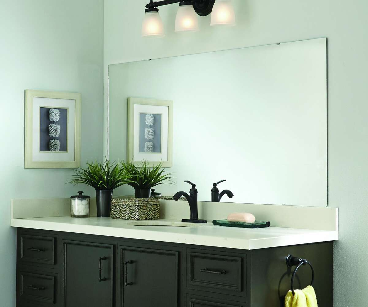 Many homes have simple, builder-grade mirrors in bathrooms, as shown in this