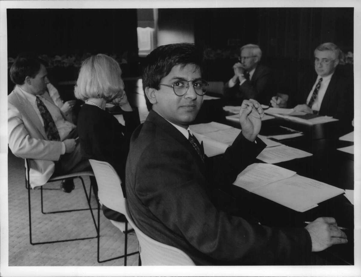 St. Rose College, Albany, New York - Student Sarwat Qizilbash presides over full meeting of President's Executive Committee after swapping places with college's usual president, Louis Vaccaro, for the day. April 21, 1993 (John Carl D'Annibale/Times Union Archive)