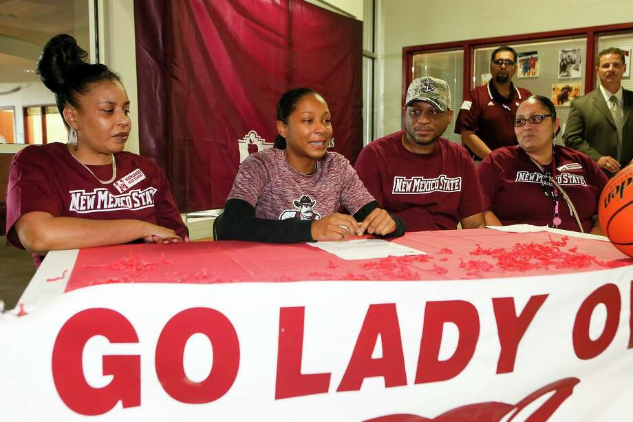Highland's Aaliyah Prince (second from left) in 2015 addresses the assembly before signing a letter of commitment to attend New Mexico State Universtiy on a basketball scholarship. Seated next to her are family members. Photo: Marvin Pfeiffer /Staff Photographer / Express-News 2015