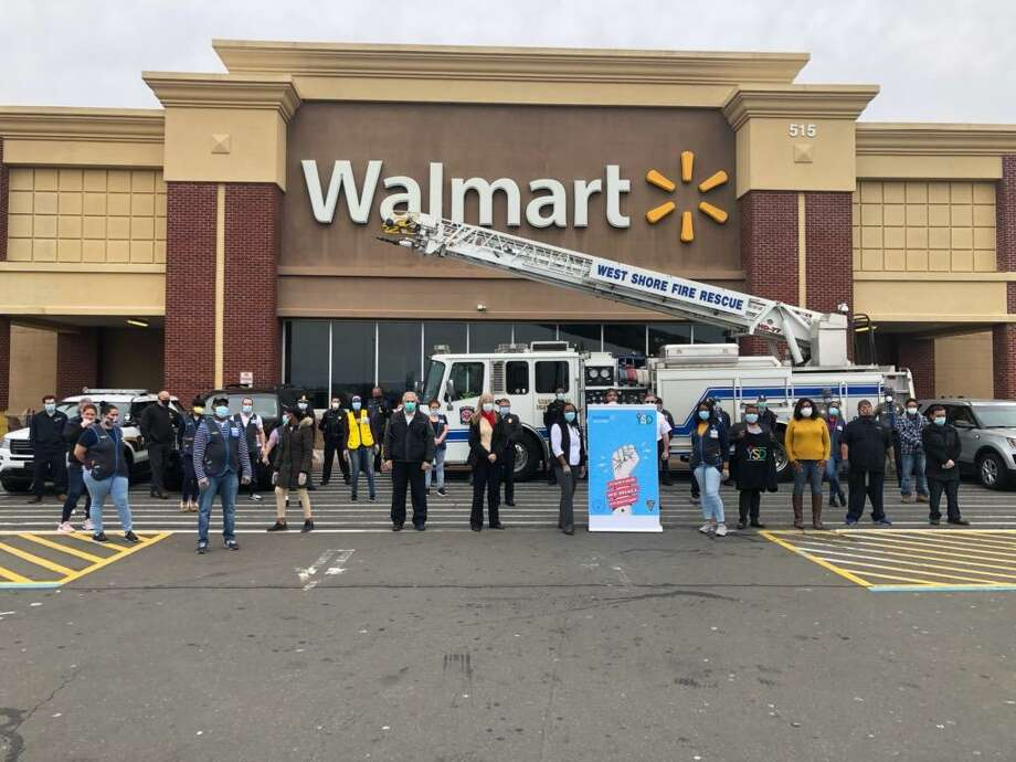 Walmart of West Haven employees donate several cases of Gatorade, water, and Lysol disinfectant spray and wipes to aid first responders in the coronavirus fight. Photo: Contributed /