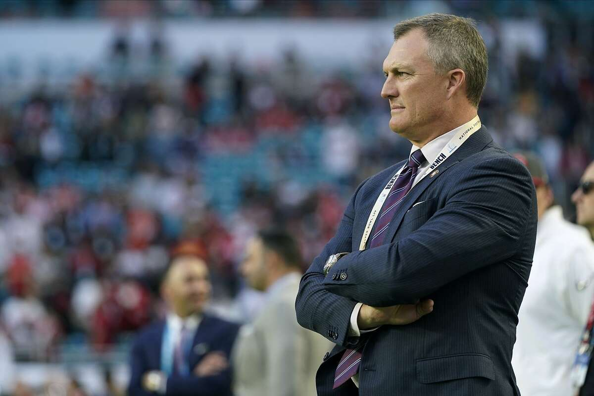 """FILE - In this Feb. 2, 2020, file photo, San Francisco 49ers general manager John Lynch watches his team warm up for NFL football's Super Bowl 54 against the Kansas City Chiefs in Miami. """"You never stay the same,"""" Lynch said at the scouting combine. """"You're either getting better or getting worse. We're into getting better. It becomes trickier with less draft equity and things of that nature, but we've got a lot of good players that are part of us moving forward as well."""" (AP Photo/David J. Phillip, File)"""