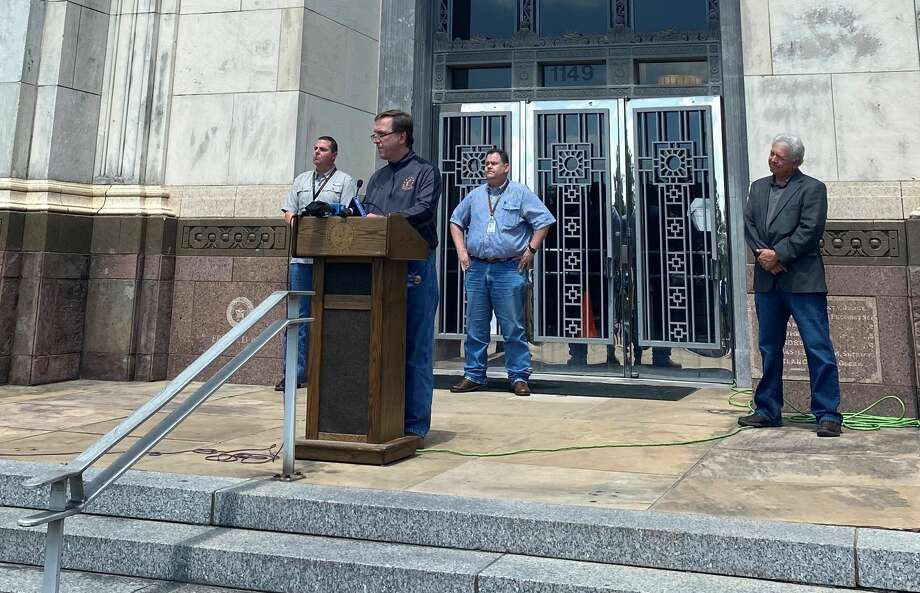 Judges from Hardin, Jasper, Jefferson and Orange counties address members of the media from the steps of the Jefferson County courthouse on April 20, 2020. Photo: Kaitlin Bain/The Enterprise