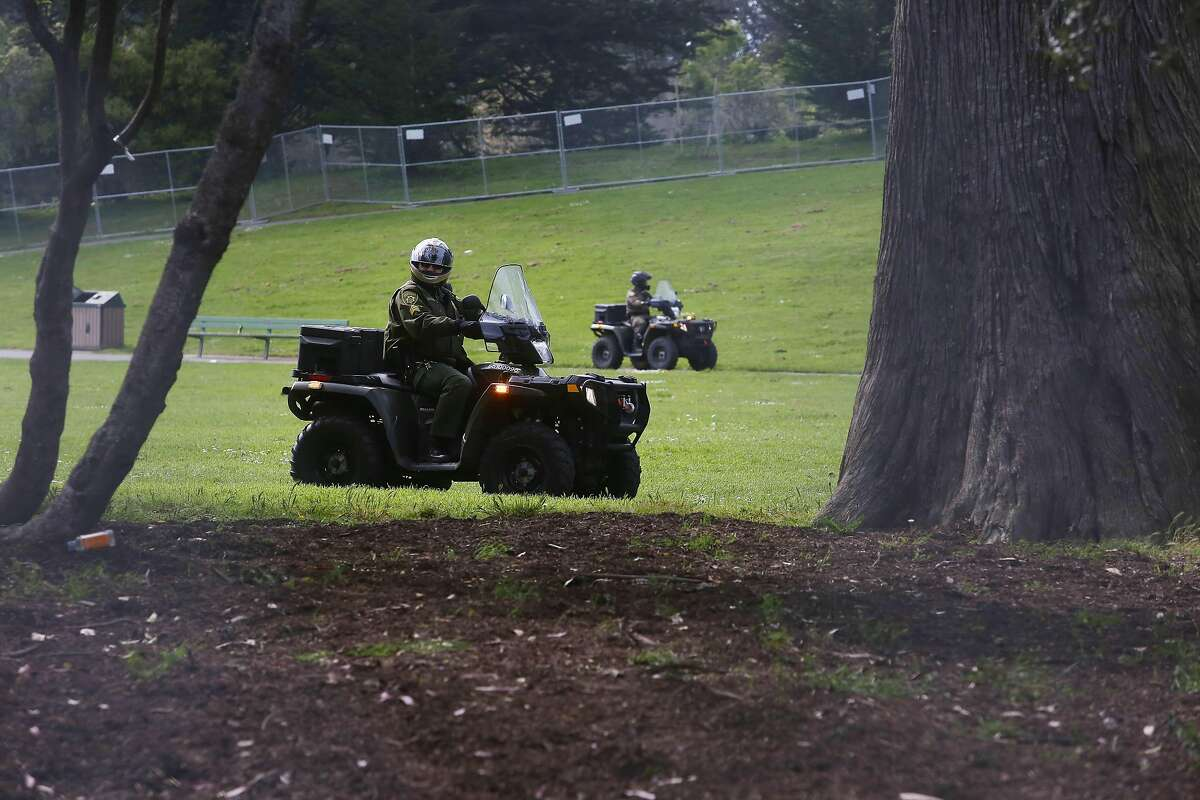 Park rangers patrol the closed and fenced in area around Robin Williams Meadow and Hippie Hill in Golden Gate Park on 420 day on Monday, April 20, 2020 in San Francisco, Calif.