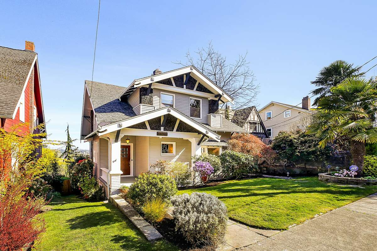 Preserved and updated since its 1912 birthday, this North Admiral craftsman is for sale at $1.475M