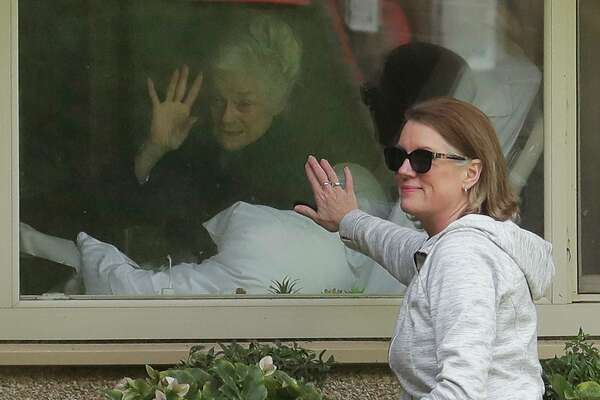 """A reader decries the lack of focus on nursing homes from federal officials during the COVID-19 pandemic. Here, a nursing home resident near Seattle """"visits"""" with her daughter."""