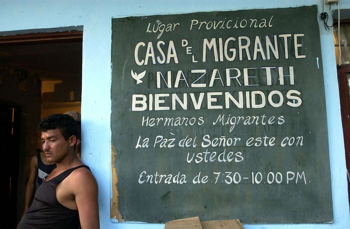 Cesar Laura is one of many who will pass through Casa Migrante Nazareth while making their way to the United States Tuesday, June 10, 2003 in Nuevo Laredo. Casa Migrante Nazareth helps feed, clothe, and provide shelter for a week for migrants who wish to cross into the States. CHRISTOBAL PEREZ/HOUSTON CHRONICLE. HOUCHRON CAPTION (06/15/2003): Cesar Laura rests in the doorway at Casa del Migrante Nazareth in Nuevo Laredo.