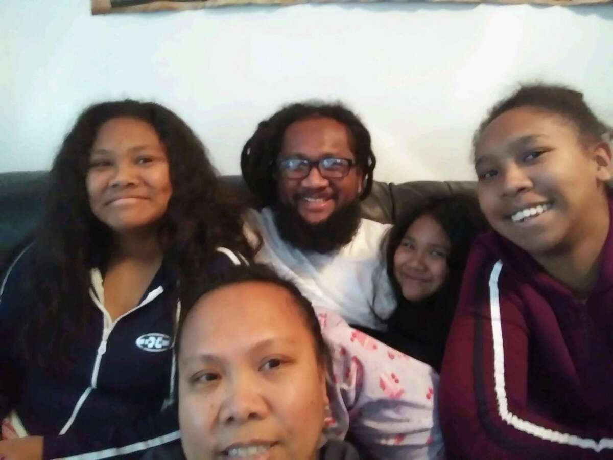 Charles Joseph (center) with his wife and children. Joseph, who has asthma, was released after attorneys filed a lawsuit.