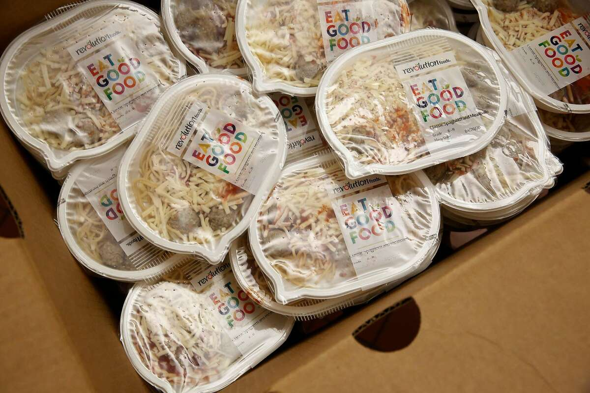 A box filled with meals of spaghetti and meatballs are seen at Mission High School as San Francisco Unified School District school meal bags are prepared at Mission High School on Monday, April 20, 2020 in San Francisco, Calif.
