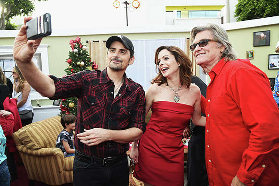 """Brad Paisley, Kimberly Williams-Paisley and Kurt Russell attend """"The Christmas Chronicles"""" Premiere on Nov. 12, 2018, in Los Angeles. Photo by Michael Kovac/Getty Images for Netflix"""