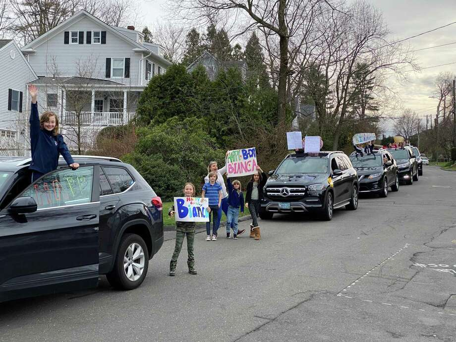 Families recently gather for a drive-by Birthday celebration in New Canaan to celebrate the Birthday of 8-year-old Bianca Magratten. The Town of New Canaan is currently doing its part to celebrate the Birthdays of children in kindergarten through the fourth grade because of Birthday celebrations being canceled, and postponed due to restrictions on social gathering during the coronavirus pandemic. Photo: Contributed Photo