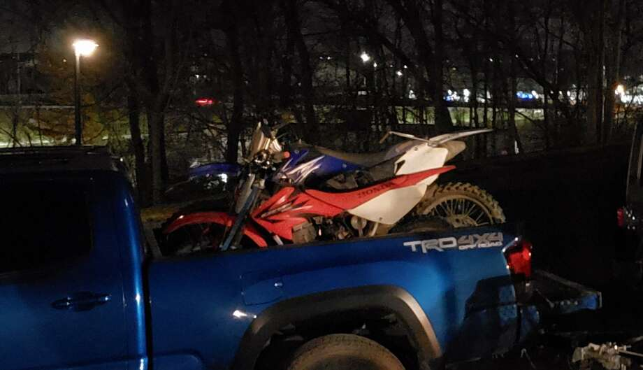 The red and white 2006 Honda CRF80 stolen in Danbury, Conn. Photo: Contributed Photo