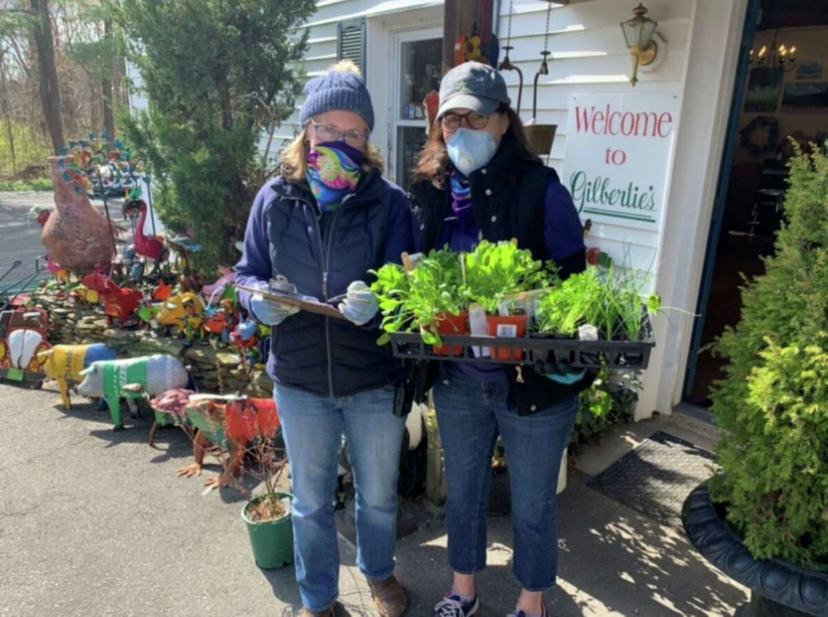 Staff at Gilbertie's Organics wear masks while preparing orders for clients.