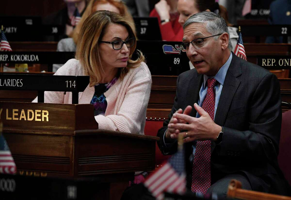 House Minority Leader Themis Klarides, R-Derby, left, talked with Senate Minority Leader Len Fasano, R-North Haven, in a 2019 file photo.