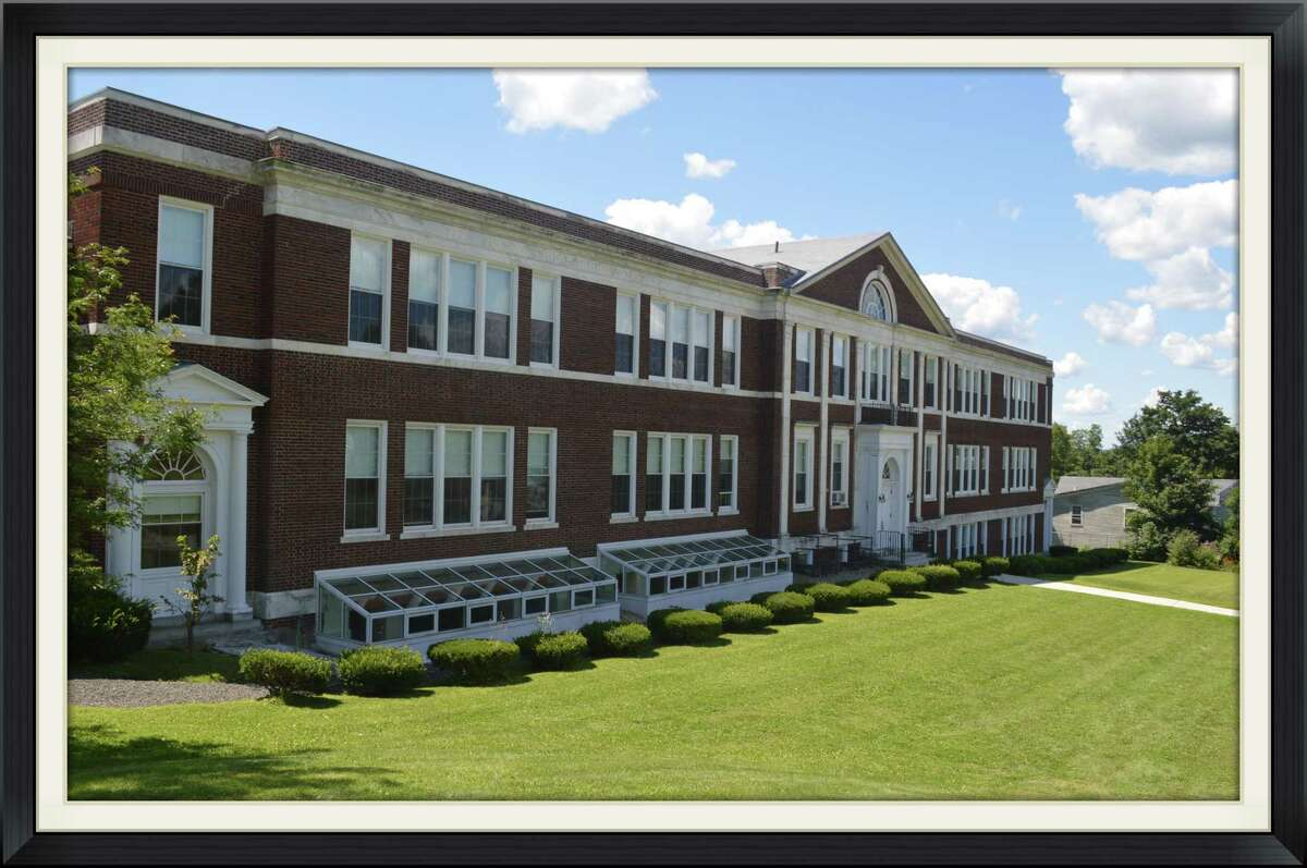 Litchfield's public schools all have solar panels. Pictured are Litchfield High School and Litchfield Center School.