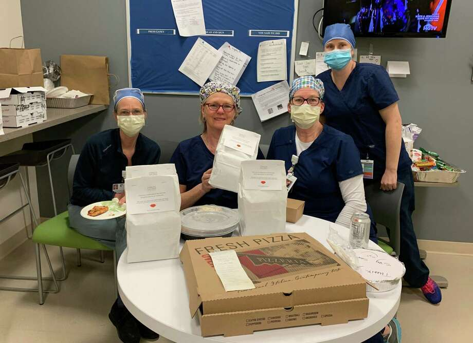 ICU and emergency room nurses and staff at Norwalk Hospital enjoy pizza donated by neighbors on Chestnut Hill Road in Wilton. Photo: Contributed Photo