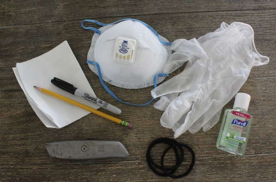 Kate Dempsey's newly extended toolkit, which includes papers stating that she is an essential worker. Photo: Kate Dempsey