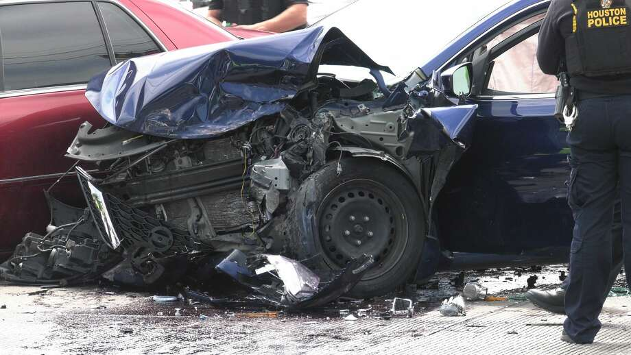 Houston police investigate a pursuit that ended in a violent wreck, which sent the driver of the fleeing car to the hospital Monday, April 20, 2020. Photo: Jay R. Jordan / Houston Chronicle