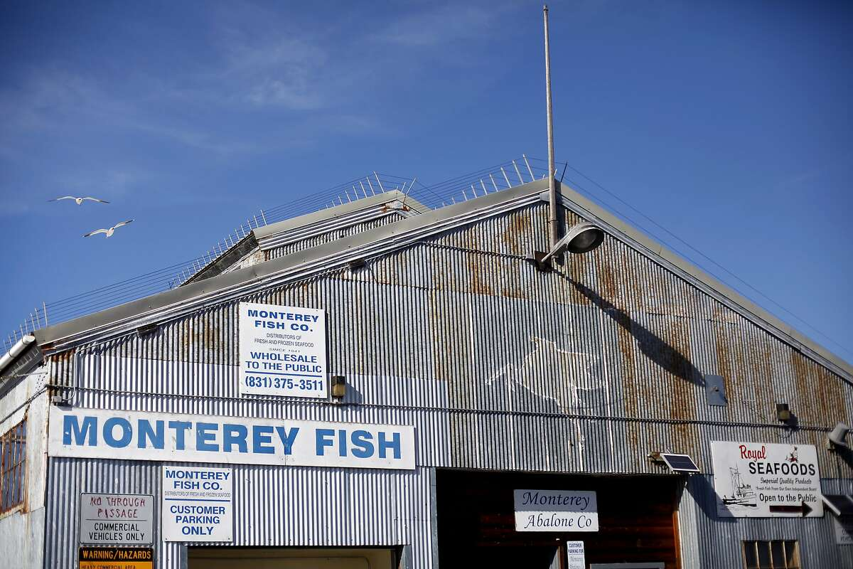 The Monterey Abalone Company sits at the end of the commercial wharf, next to Monterey Fish, in Monterey, Calif., on Wednesday, February 19, 2014.