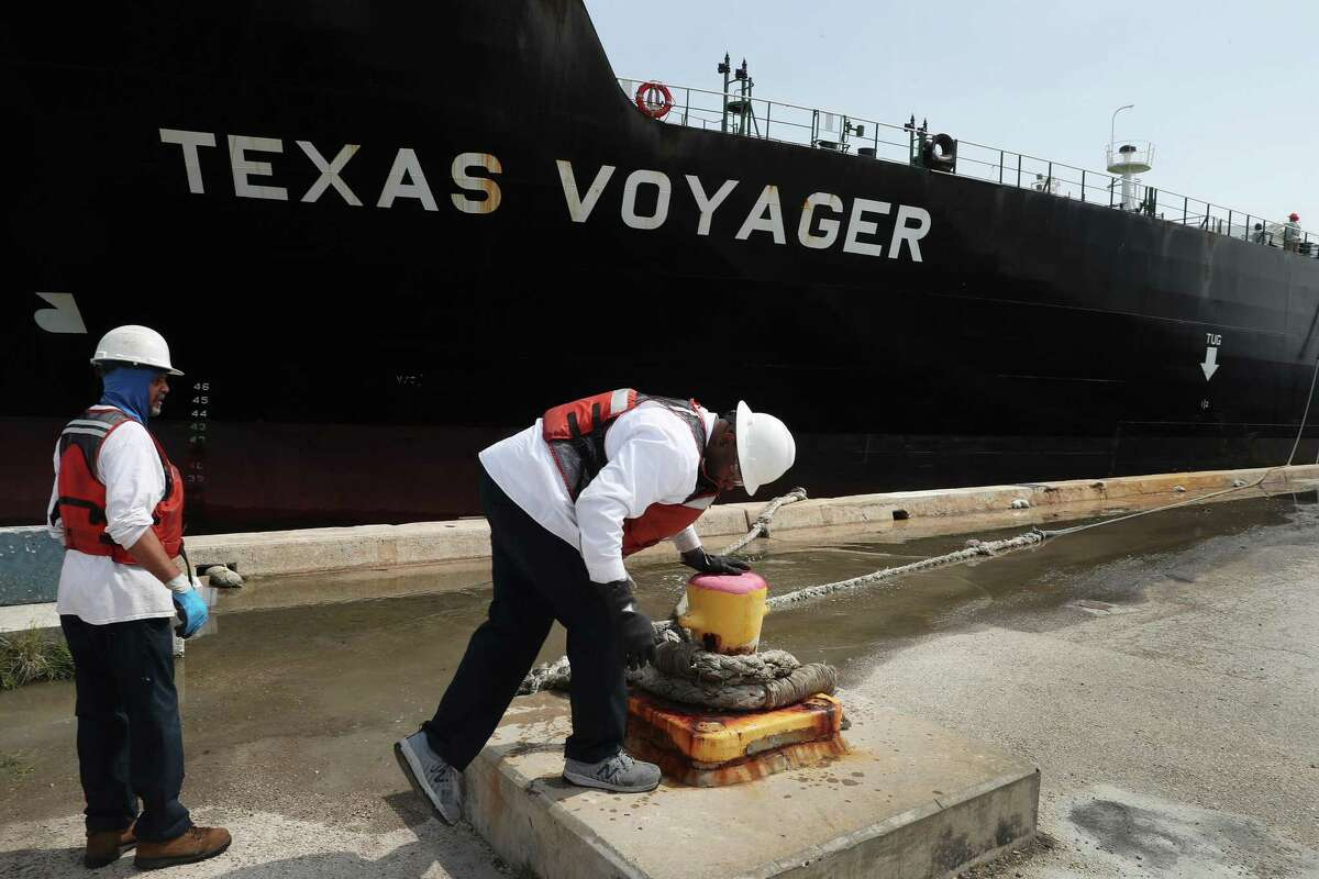 FORT LAUDERDALE, - APRIL 21: Line handlers help dock the oil tanker, Texas Voyager, as it pulls into its mooring to offload its crude oil at Port Everglades on April 21, 2020 in Fort Lauderdale, Florida. The price of West Texas Intermediate oil futures for delivery in May fell yesterday to -$37 per barrel for the first time in history. The price continues to be at record lows as demand for crude oil has decreased amid the coronavirus pandemic. (Photo by Joe Raedle/Getty Images)