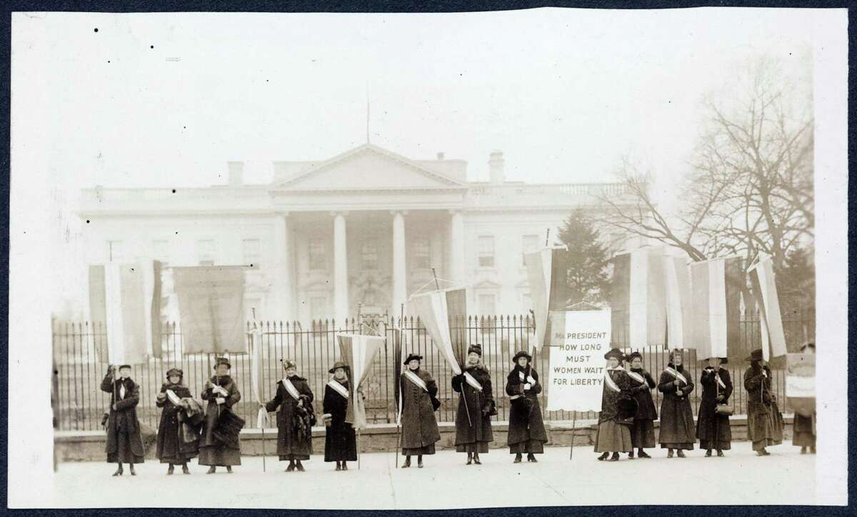 Members of the National Woman's Party picket the White House during the fight for a woman's right to vote.
