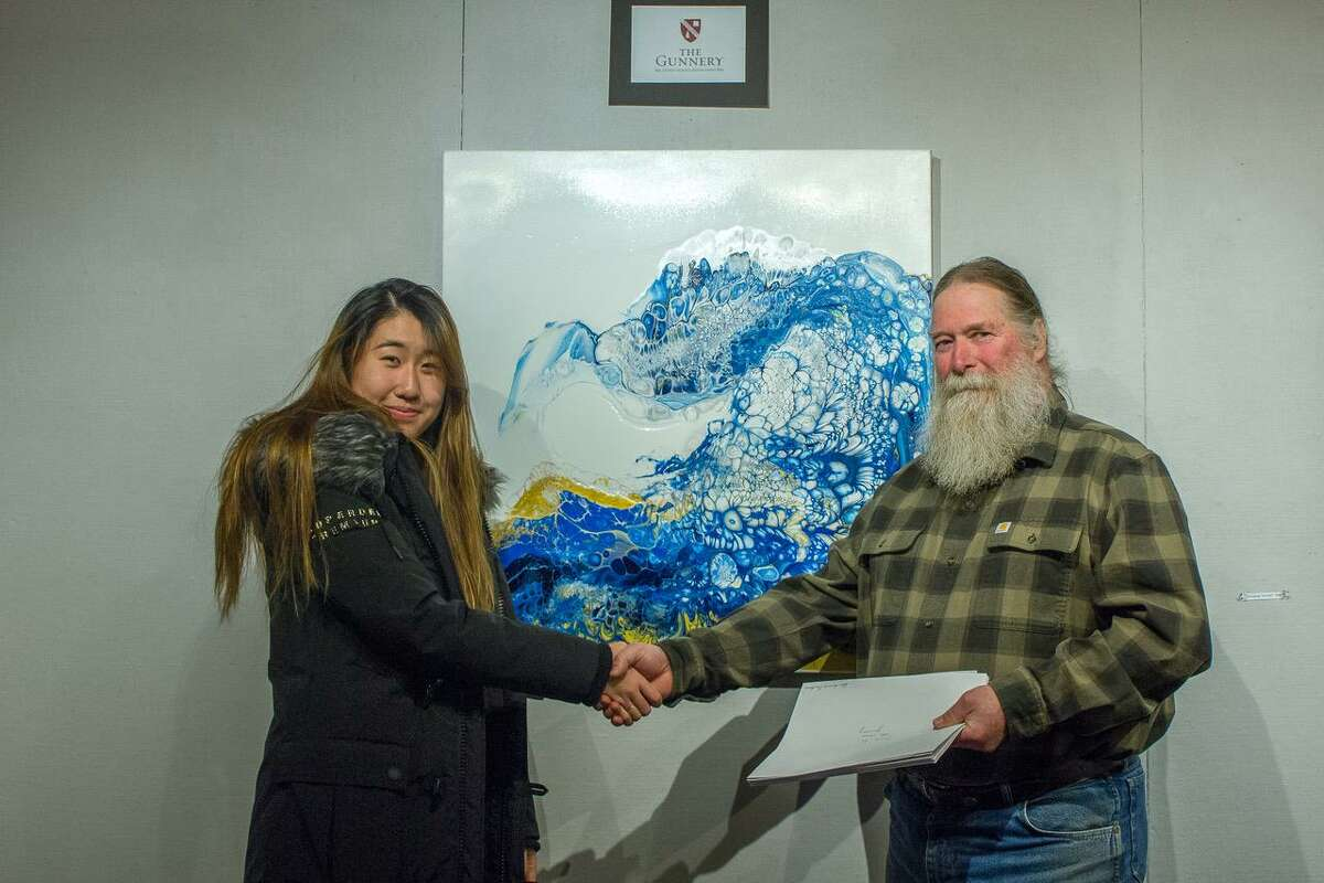 """Tixin Zu of The Gunnery in Washington was among the students who participated in the show. She is shown above with show chairman Michael Spross with her piece, """"The Wave."""""""
