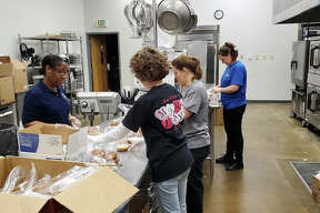 District 7 Café workers prepare food for student meals at Edwardsville High School on Wednesday morning. During the COVID-19 pandemic, any family with children in District 7 can pick up five breakfasts and five lunches from 10 a.m. to noon on Mondays at Glen-Ed Pantry, 125 Fifth St. in Edwardsville.