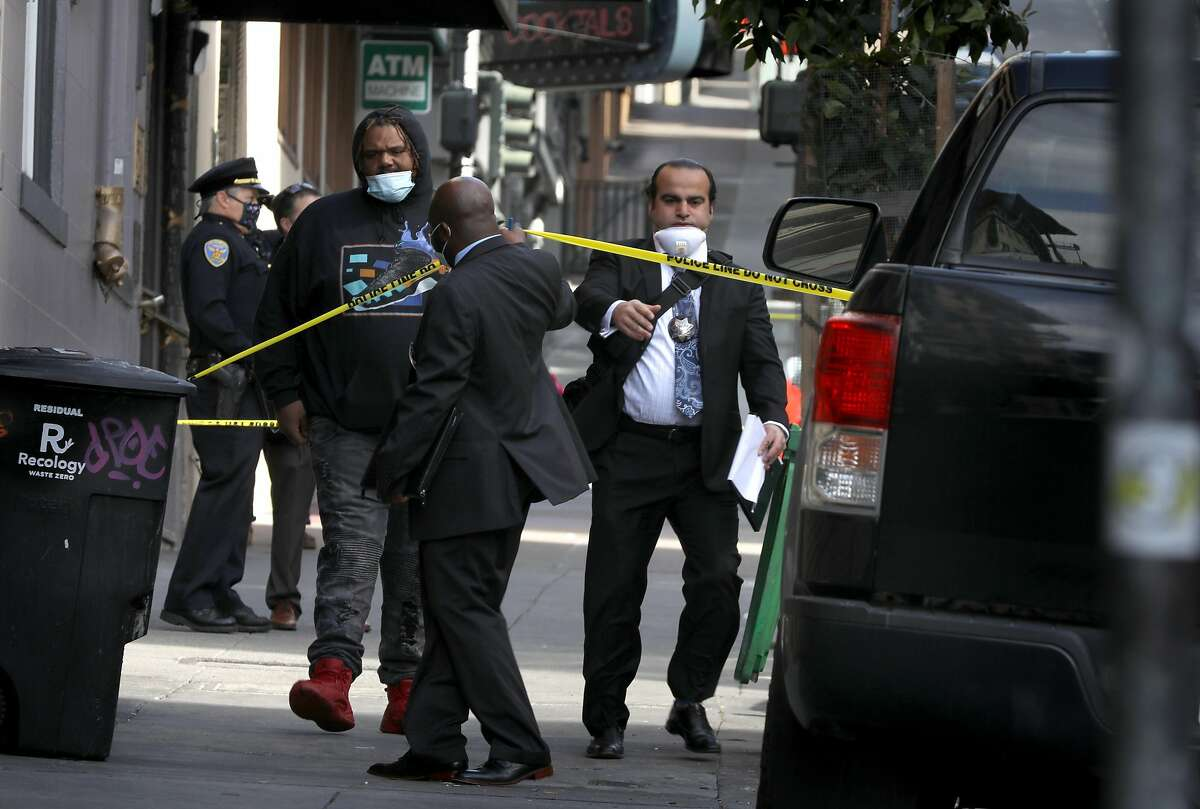 Police and investigators on scene at the 500 Block of Jones Street where gunshots were heard early this morning on Tuesday, April 21, 2020, in San Francisco, Calif.