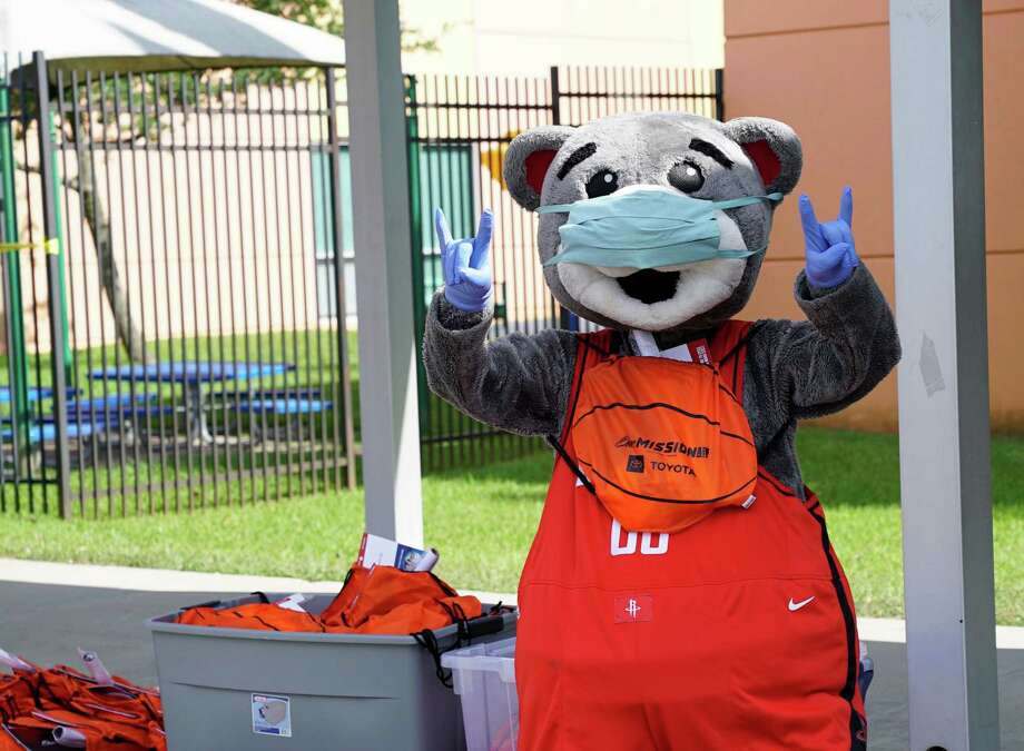 The Houston Rockets mascot, Clutch, joined the Boys & Girls Clubs of Greater Houston (BGCGH) during a drive-through food pantry at the Spring Branch Club to provide 200 families with a week's worth of food.