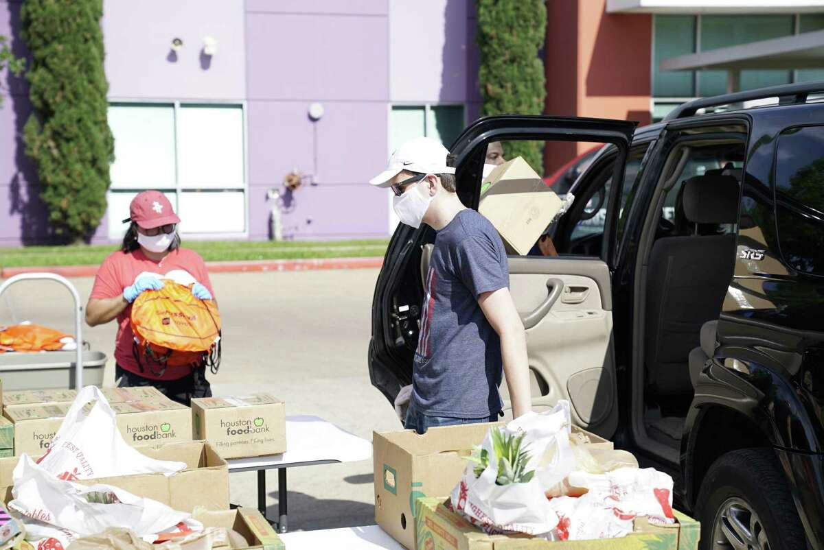 The Houston Rockets mascot, Clutch, joined the Boys & Girls Clubs of Greater Houston (BGCGH) during a drive-through food pantry on Friday at the Spring Branch Club to provide 200 families with a week's worth of food.