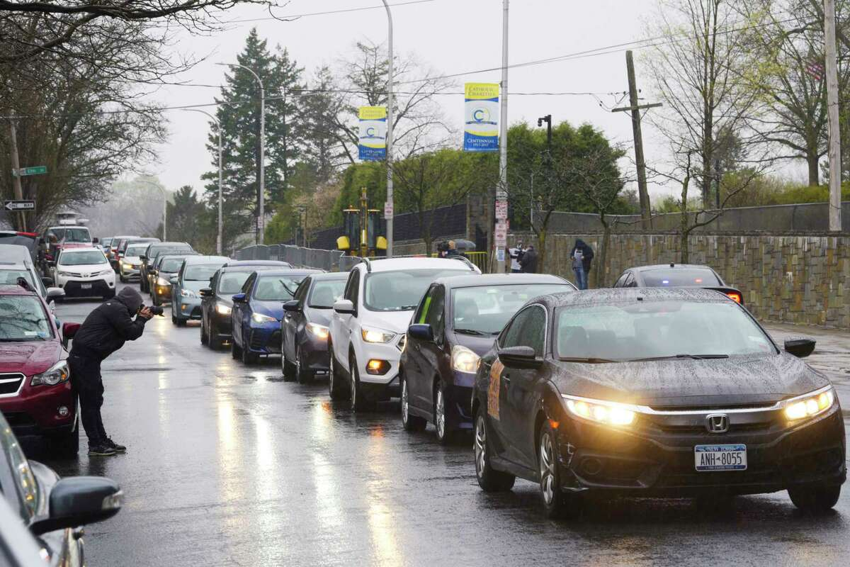 Advocates calling for the release of medically vulnerable prisoners because of the pandemic, honk their car horns as they held a protest outside the New York State Executive Mansion on Tuesday, April 21, 2020, in Albany, N.Y. (Paul Buckowski/Times Union)