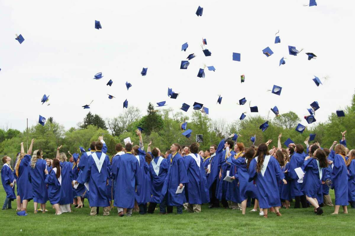 Seniors in theMorley Stanwood High School class of 2018 throw their caps in the air during their graduation ceremony. The board of education is still discussing what graduation will look like for seniors of the class of 2020. (Pioneer file photo)
