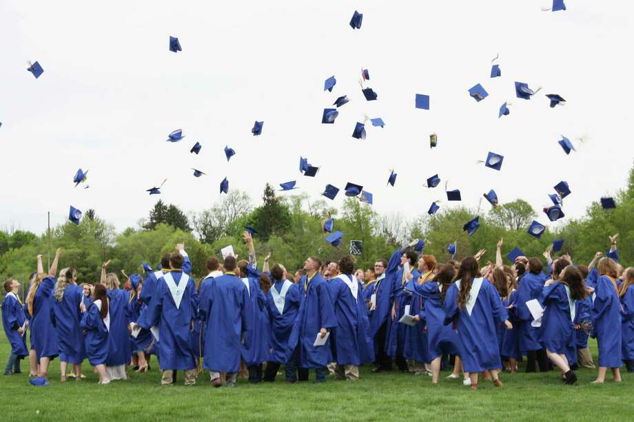 Seniors in the Morley Stanwood High School class of 2018 throw their caps in the air during their graduation ceremony. The board of education is still discussing what graduation will look like for seniors of the class of 2020. (Pioneer file photo)