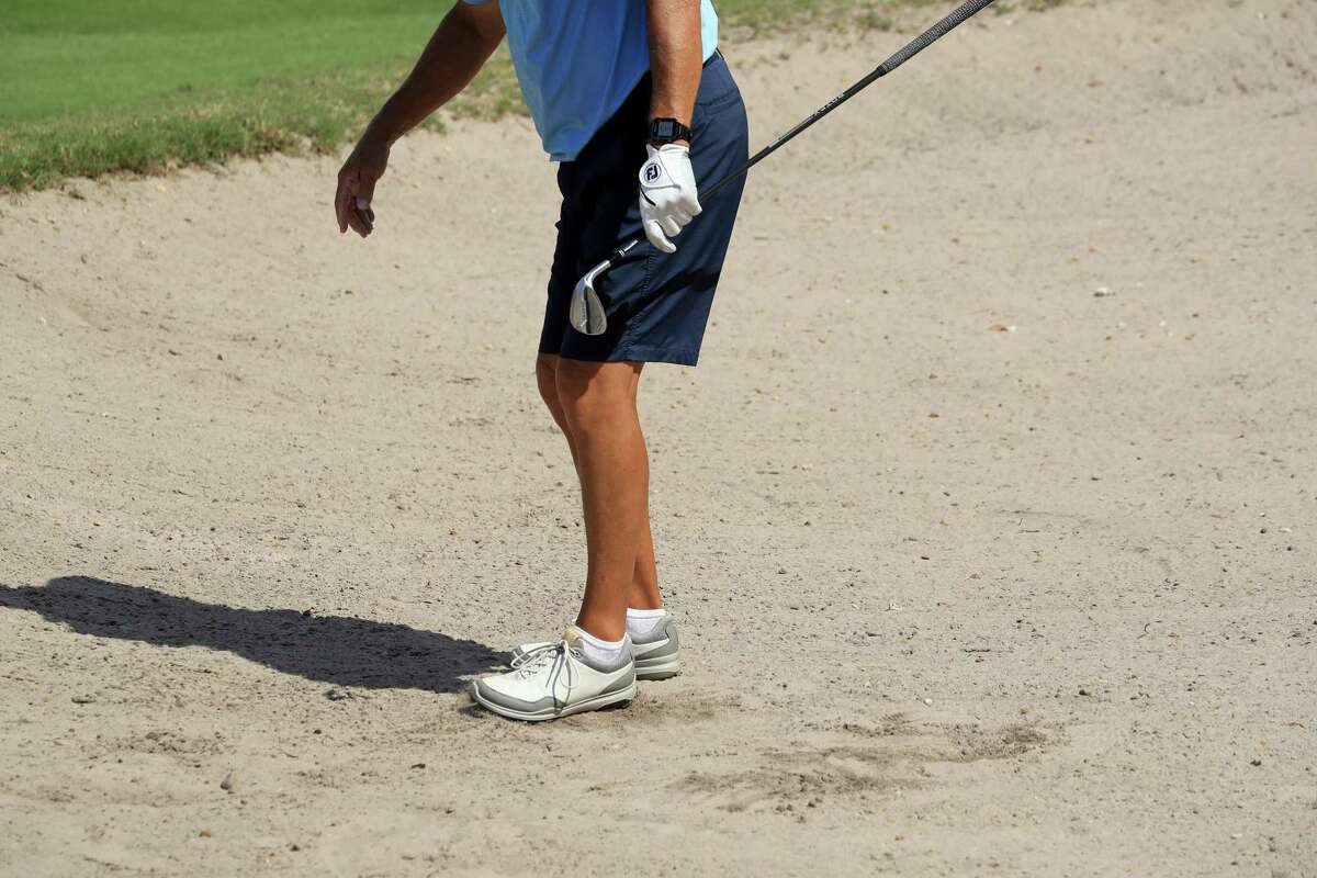 JACKSONVILLE BEACH, FLORIDA - MARCH 25: A golfer uses his foot to smooth out a bunker at Windsor Parke Golf Club since all rakes have been removed as a part of the 'No Touch' policy amid the Coronavirus outbreak on March 25, 2020 in Jacksonville Beach, Florida. The World Health Organization declared coronavirus (COVID-19) a global pandemic on March 11. (Photo by Sam Greenwood/Getty Images)