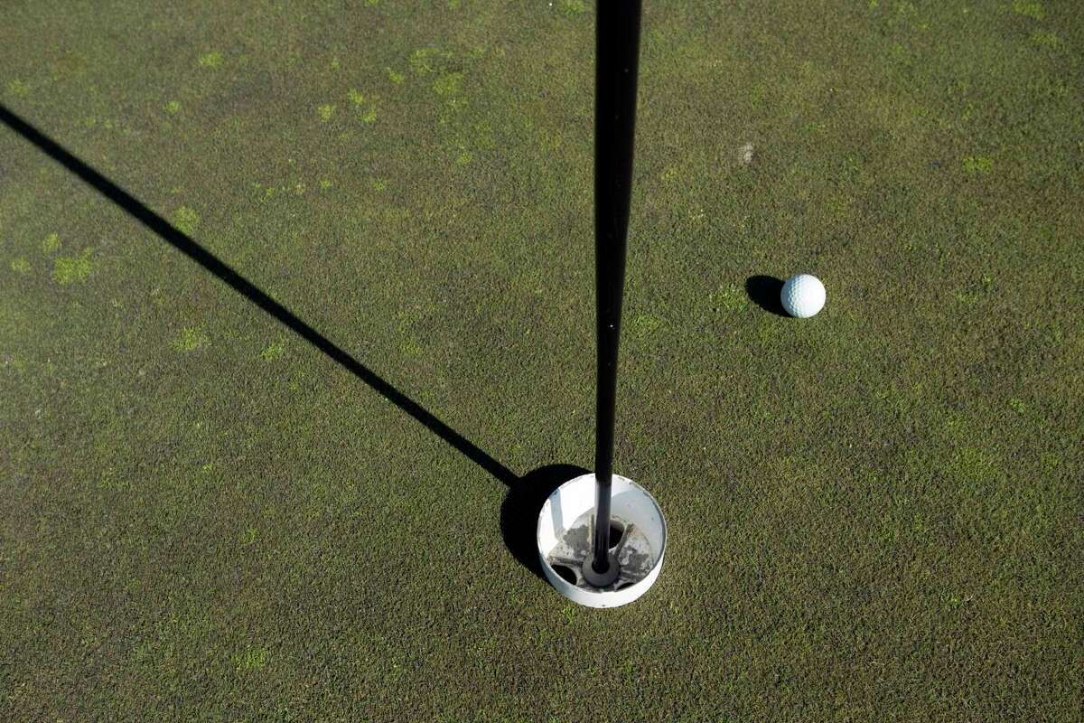 A raised liner cup at Elk Ridge Golf Course in Carson, Wash., on Thursday, March 19, 2020. To reduce the risk of coronavirus infection when players retrieve their balls after a sunk putt, many courses raised the liner cups, which are normally buried inside holes; accordingly, the U.S.G.A. changed the definition of a sunk putt. (Michael Hanson/The New York Times)