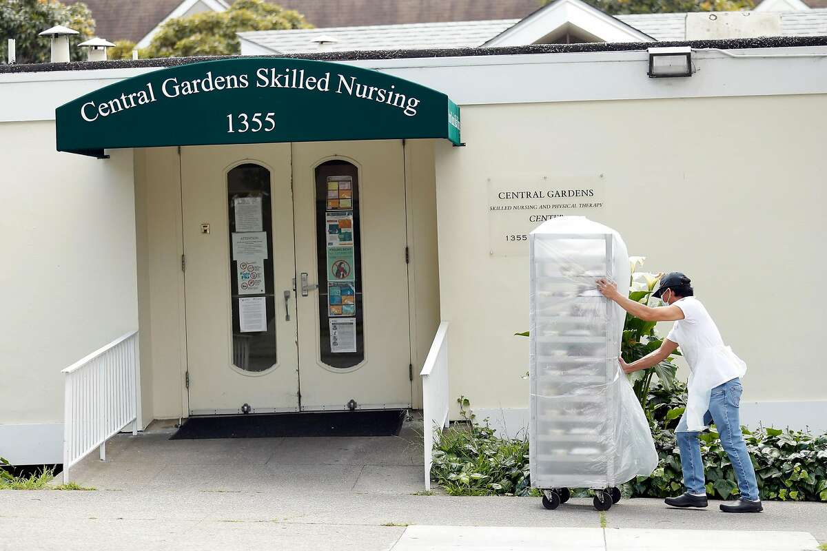 An employee brings meals into Central Gardens Skilled Nursing facility on Ellis Street in San Francisco, Calif., on Sunday, April 19, 2020.