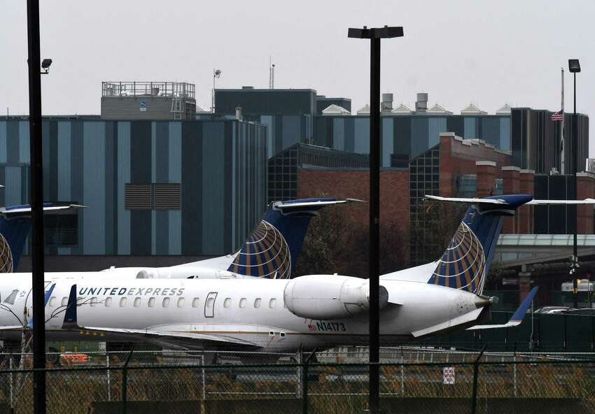 United Airlines regional jets are parked at Albany International Airport, as the coronavirus pandemic continues to impact air travel on Tuesday, April 21, 2020, in Colonie, N.Y. (Will Waldron/Times Union)