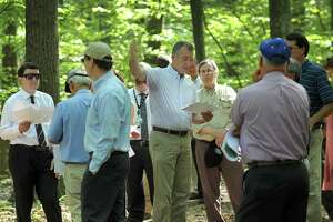 Joel Lindsay, center, with Ameresco Candlewood Solar LLC, leads a walking tour for the state Siting Council of the area where there is a proposal to build solar panels on Candlewood Mountain in New Milford, Tuesday, Sept. 26, 2017.