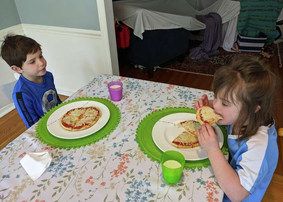 """We're not super adventurous nor are we culinary experts,"" says Senior Reporter Maggie Reardon. ""So it's just plain cheese pizzas with store-bought pizza dough for my kiddos. I managed to snag some premade pizza dough at the store a couple of weeks ago and froze it. I've been defrosting as needed. We made personal pizzas for lunch today. My 5-year-old has 'Pizza Mondays' at his preschool, so we're trying to keep the tradition going at home."" Photo: CBSI/CNET"