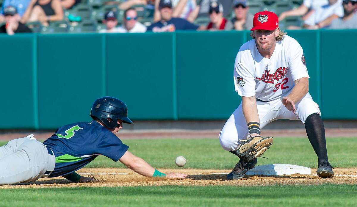 Tri-City ValleyCat first basemen Zach Biermann digs out a pickoff attempt in front of Vermont Lake Monsters baserunner Nick Ward at the Joseph L. Bruno Stadium in Troy, NY on Sunday, June 23, 2019 (Jim Franco/Special to the Times Union.)