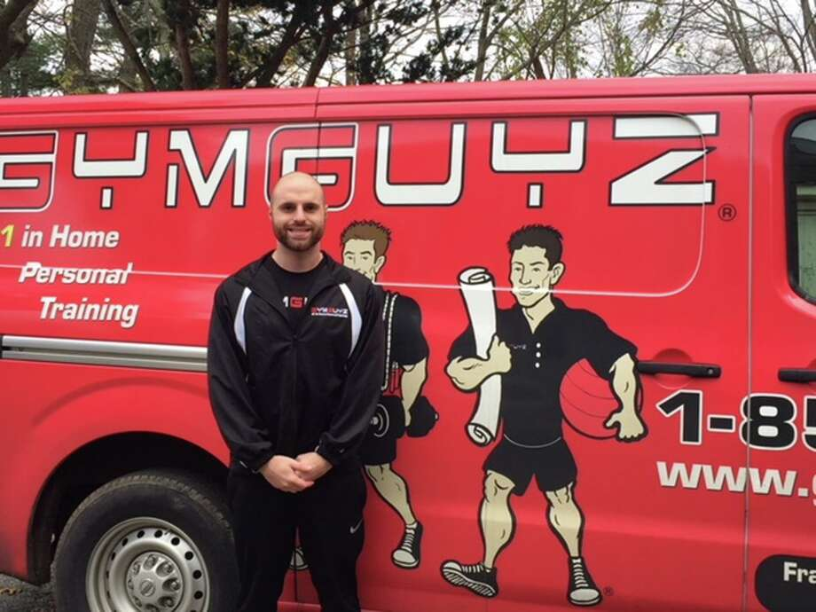 Dan Spano with his GymGuyz van. Spano's family said he died April 11 from complications arising from COVID-19. Photo: Contributed Photo / Hearst Connecticut Media
