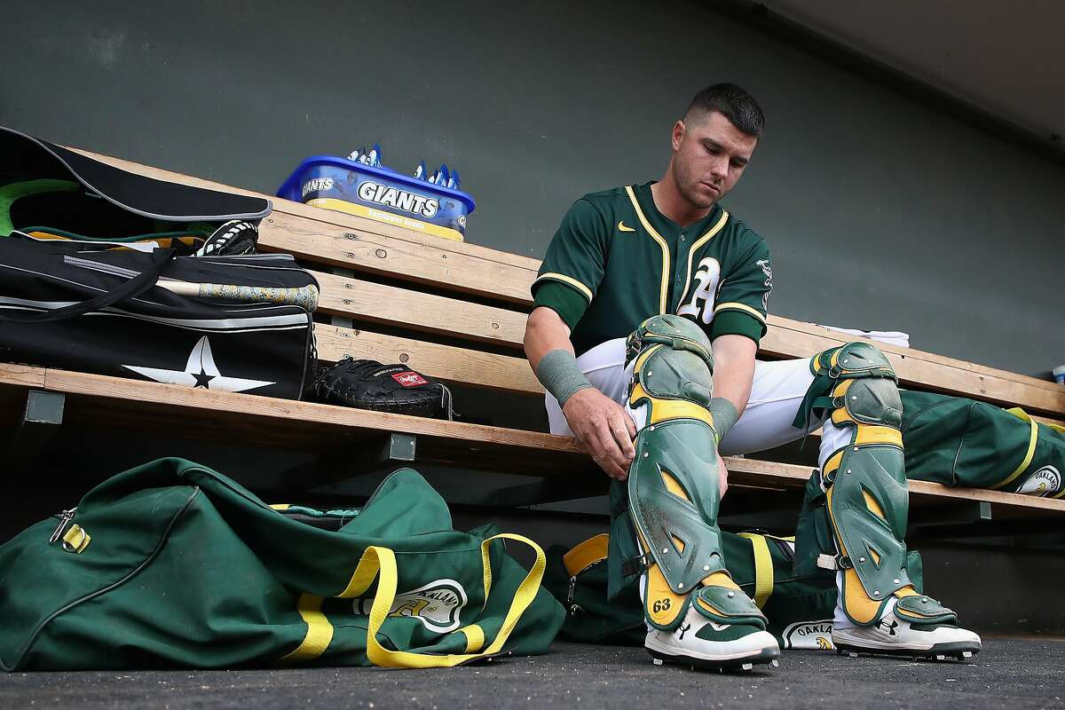 MESA, ARIZONA - MARCH 10: Catcher Austin Allen #30 of the Oakland Athletics in the dugout before the MLB spring training game against the Oakland Athletics at HoHoKam Stadium on March 10, 2020 in Mesa, Arizona. ~~