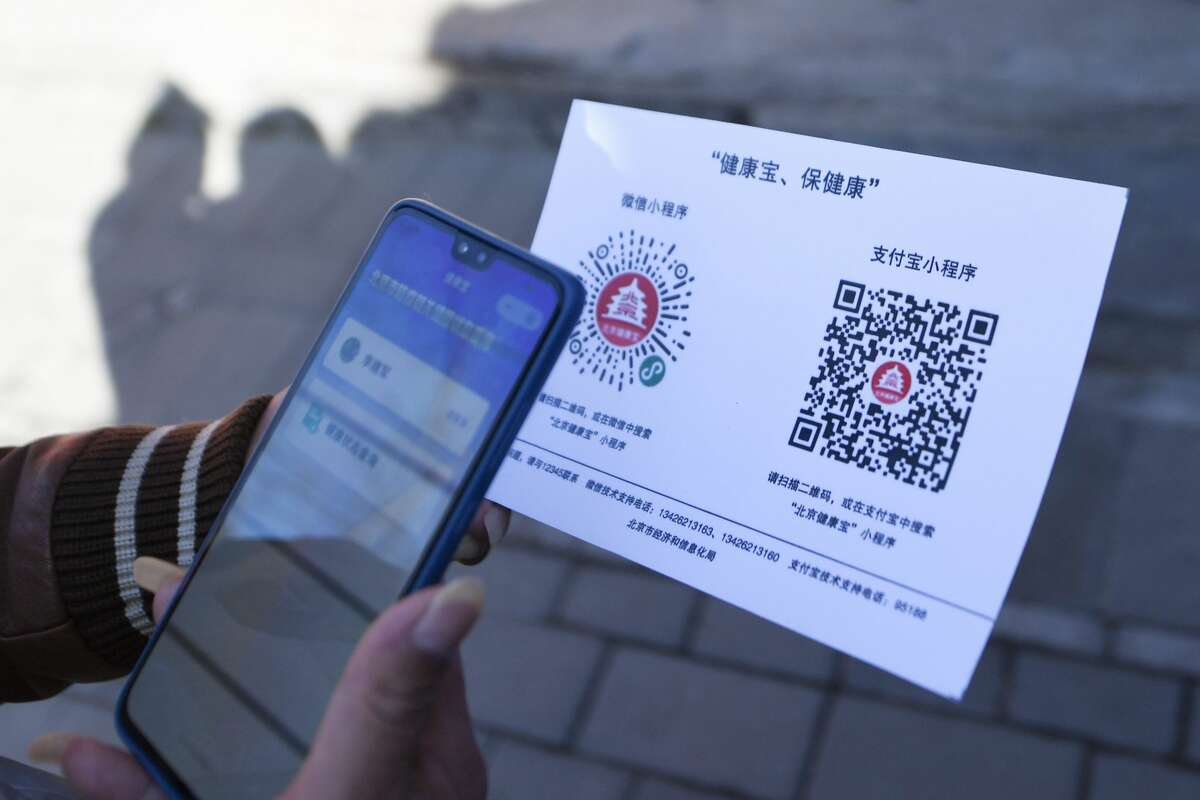 QR codes Residents in China are using QR codes to gain entry to businesses, such as restaurants; it's all part of a color-based health code system. Users sign up for the health code system and are required to enter personal information and answer a series of questions, such as previous travel, if you've had contact with a COVID-19 patient (suspected or diagnosed) and any symptoms you may be experiencing. You are then issued a red, amber or green color. Those with a red code will have to go into self-quarantine for 14 days; amber requires a quarantine period of seven days; green means you are allowed to move around the cities. Restaurants, based on the color of your health QR code, can either let you enter or turn diners away. To read more about the system, head to CNN. Shown: A resident who has returned to Beijing scans a QR code to register personal information at a neighborhood committee in Xiaojingchang Hutong in Dongcheng District of Beijing, capital of China, on March 10, 2020.
