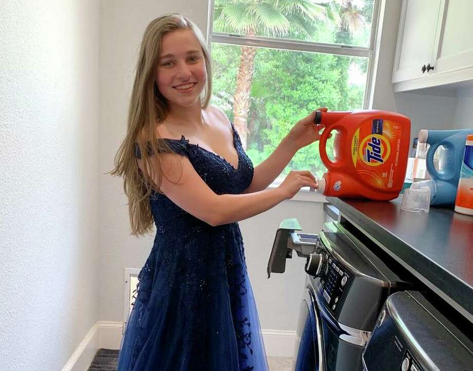 """Kingwood High School Senior Rachel Henryhad planned to attend prom with a group of friends on April 18, later rescheduled for May 9. They all decided to put on their dresses and do chores around the house over a video call """"to lighten the mood a bit,"""" Henry said. Pictured: Rachel Henry Photo: Courtesy / Courtesy"""