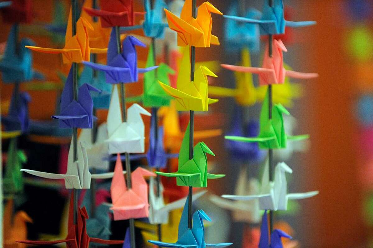 """Nghiep Luu, 29, created """"My Wish to You,"""" an origami art exhibit made of of 10,000 cranes, Wednesday, Nov. 2, 2016."""