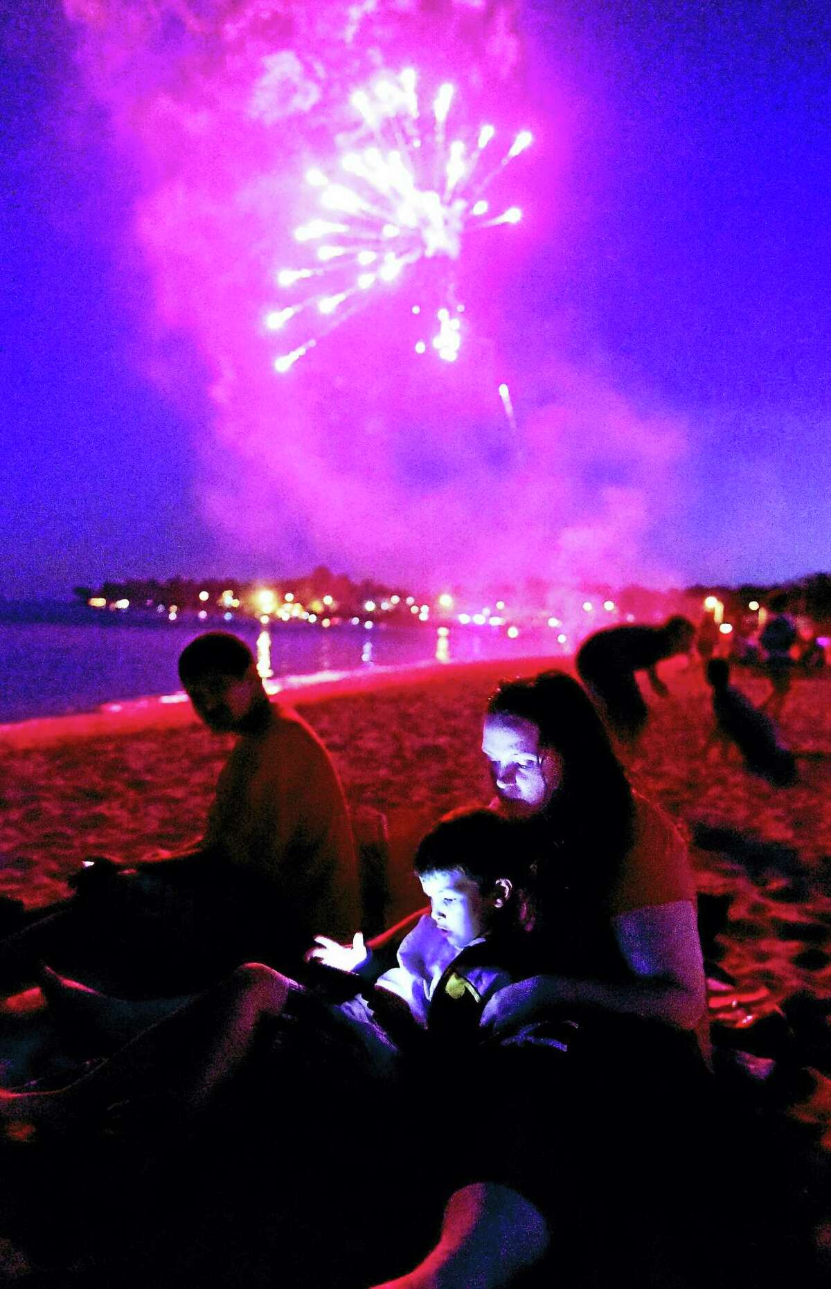In this file photo, personal fireworks burst in the air near Stony Beach and before the start of the West Haven Fireworks on Savin Rock as West Haven celebrated Independence Day.
